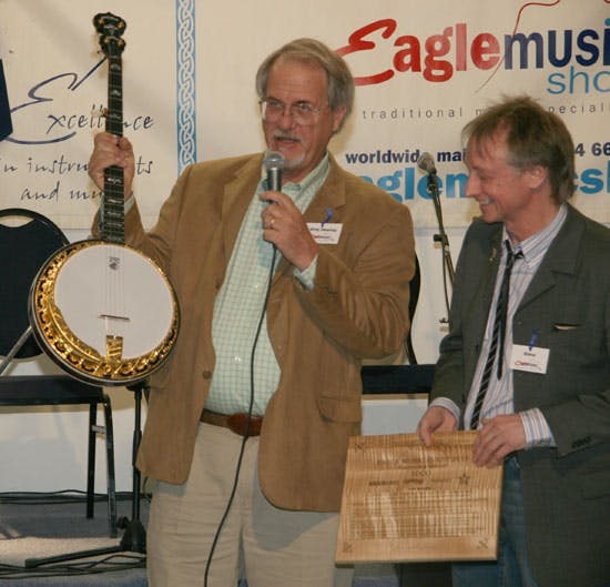 Greg Deering awards Steve Noon with Deering Banjo